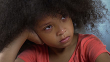 Lonely Sad African American Girl Sitting At Table, Racism And Bulling At School