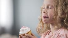 Adorable Little Girl Eating Ca...
