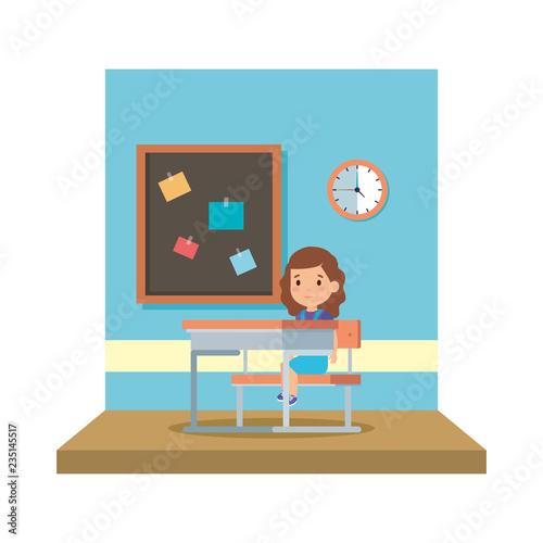 Photo  little schoolgirl sitting in schoolchair in the classroom