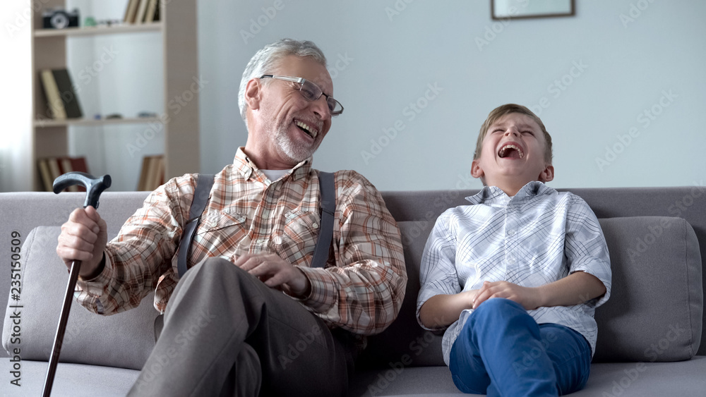 Fototapety, obrazy: Old man and boy laughing genuinely, joking, valuable fun moments together