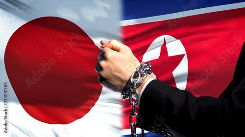 Japan sanctions North Korea, chained arms, political or economic conflict Wallpaper Mural