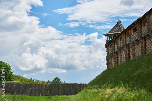 Photo Fragment of a wooden fortress with tower, a wall and a palisade