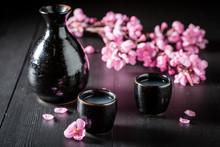 Unfiltered Strong Sake In Black Ceramics On Dark Table