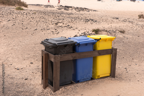 Tuinposter Canarische Eilanden Three colorful recycle bins on the beach. Fuerteventura. Canary Islands