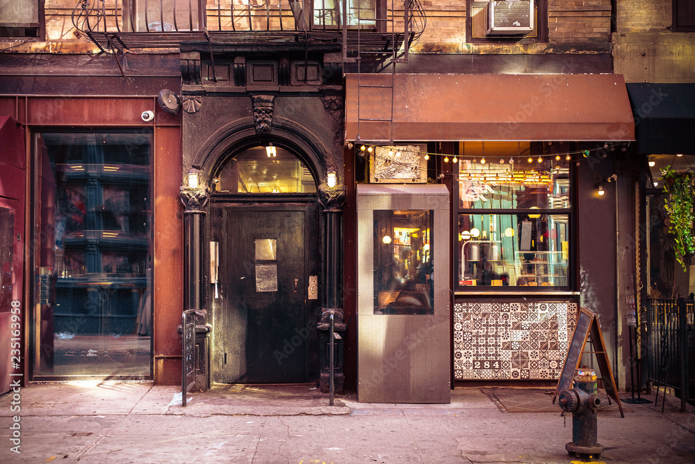 Fototapeta Storefronts from old New York City building exterior