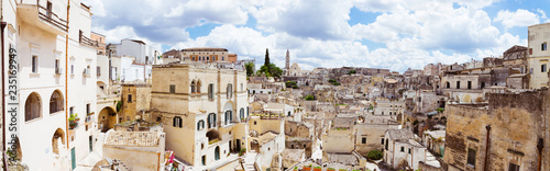 Spectacular panoramic view of ancient cave dwellings in Matera's Sasso Barisano, Italy - 235169949