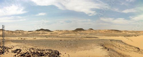 Poster Desert Libyan desert with cloudy blue sky in Egypt