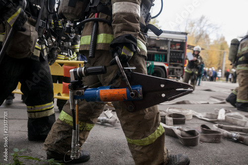 Firefighters work on an extrication using a hydraulic rescue tool