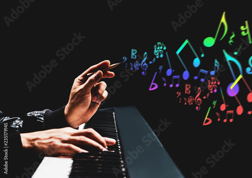 male songwriter hands composing a song on piano. song writing, music education concept - 235179145