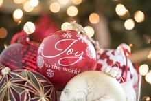 Christmas Photograph Of A Basket Of Christmas Tree Ornaments With Christmas Lights