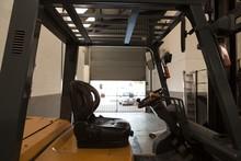 Forklift Truck In Robotic Warehouse