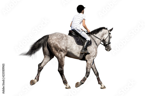 Photographie Boy riding a horse isolated on white background.
