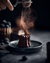 Man Sprinkling Cocoa On Mini C...