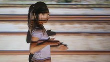 Young Woman Makes Train Motion With Arms. Tracks Moving Past. Projected Film On Female Model.