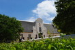 canvas print picture - Groot Constantia homestead from the vineyards, Cape Town, South Africa