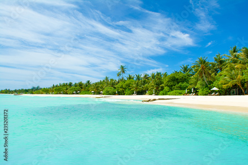 Photo Stands Turquoise Beautiful sandy beach with sunbeds and umbrellas in Indian ocean, Maldives island