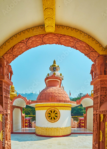 Deurstickers Asia land The view through the arch on the scenic shrine of Sitagu International Buddhist Academy, decorated with golden wheel of dharma, Sagaing, Myanmar.