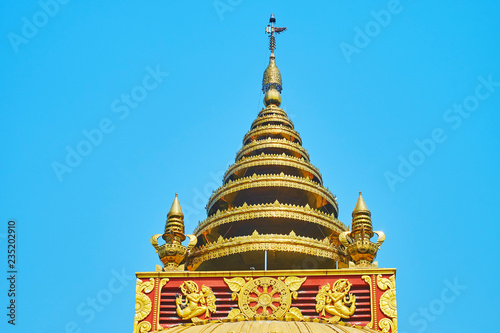Deurstickers Asia land The golden multi-staged hti umbrella of Sitagu International Buddhist Academy pagoda with relief decorative details and ringing bells, Sagaing, Myanmar.
