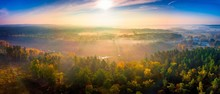 Aerial Landscape With Foggy Sunrise Over Meadows And Forest