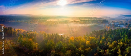 Foto auf Gartenposter Baume Aerial landscape with foggy sunrise over meadows and forest