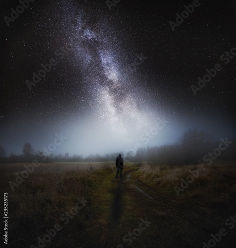 Foto auf Gartenposter Grau Verkehrs Dreamy surreal landscape with starry night sky and man silhouette