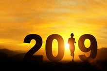 Silhouette Of Man Running In 2019 Text For Happy New Year Concept