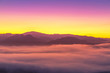 Landscape view of sunrise with white fog in early morning on the top of the hill at yun lai viewpoint, pai, Mae Hong Son, thailand