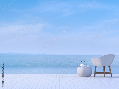 Swimming pool terrace with blurry sea view background 3d render ,There are white wooden floor.Furnished with white chair.