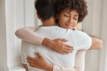 Mixed Race Brother And Sister Meet After Long Departure, Cuddle With Friendliness, Have Good Relationships. Multiethnic Relatives Give Warm Hug To Each Other. People, Support And Friendship Concept