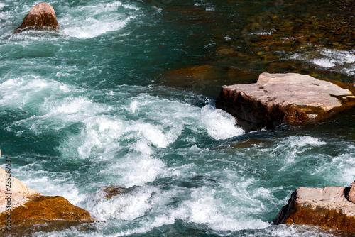 Foto op Aluminium Rivier Water mountain river and the wonderful rocky creek. Water Drops after splash. Closeup macro view