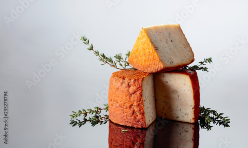 Red Pecorino sheep milk cheese with thyme and pepper.