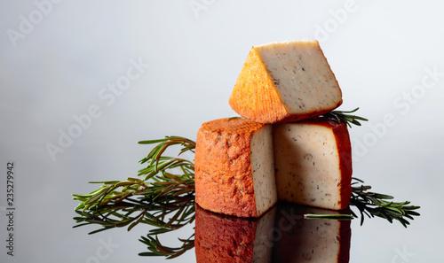 Red Pecorino sheep milk cheese with rosemary and pepper.