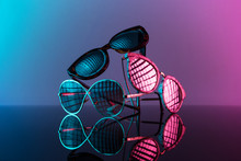 Sunglasses Stacked In A Pile W...