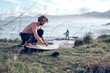 Young man cleaning surf board