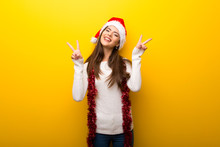Teenager Girl Celebrating Christmas Holidays Smiling And Showing Victory Sign