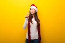 Teenager Girl Celebrating Christmas Holidays Counting Number One Sign