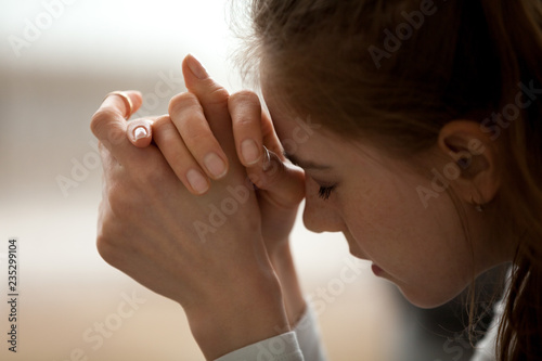 Fotografering Close up of upset woman feel down and sad having life or relationships trouble,
