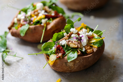 Fototapeta Baked sweet potato with salad