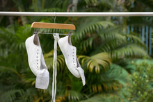 White Sneakers Hanging On Clot...