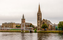 Bridge Over River Ness Leading To The Famous Tall Gothic Style Free Church Of Scotland, Inverness
