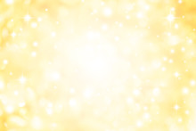 Abstract Blur Glowing Gold Yellow Color Background With Bokeh ,snow And Shine Star For Merry Christmas And Happy New Year