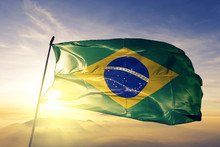 Brazil Brazilian Flag Textile Cloth Fabric Waving On The Top Sunrise Mist Fog