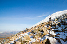 Hiking Ben Nevis In Scotland, Great Britain's Highest Mountain, On A Sunny Winter Day