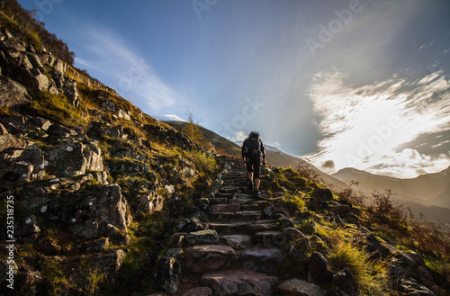 Cuadros en Lienzo Hiker climbing steep steps at Ben Nevis, Scotland's highest mountain, during ear