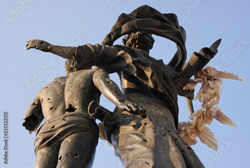 Photo Statue on Martyrs' Square in Beirut, Lebanon, with bullet holes