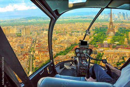 Obraz Helicopter cockpit aerial view of Tour Eiffel in Paris, French capital, Europe. Scenic flight above Paris skyline and cityscape, France. - fototapety do salonu