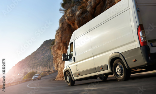 truck delivery van rush by country road Canvas Print