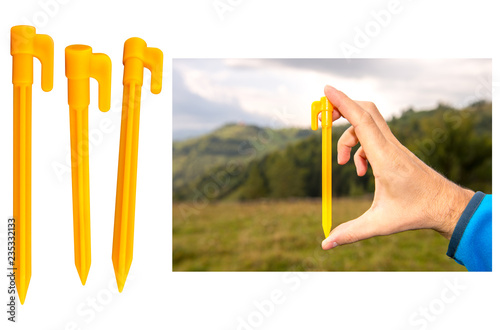 Yellow plastic tent stakes or pegs for camping Fototapeta
