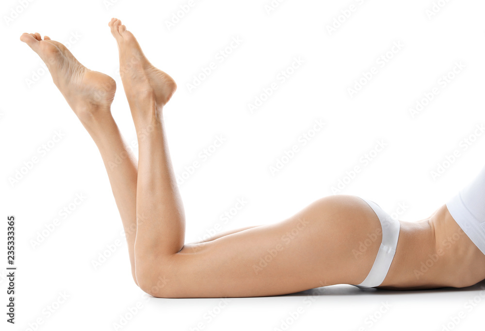 Fototapety, obrazy: Young woman with beautiful long legs on white background, closeup