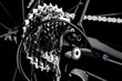 bicycle bike rear derailleur gear casette chain detail close up shot black dark background